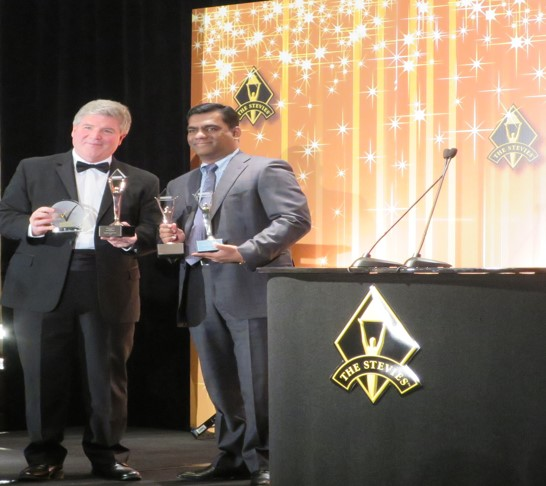 Vetri Selvan, CEO RheinBrücke IT Consulting receives the International Business Stevie Awards from Michael Gallagher